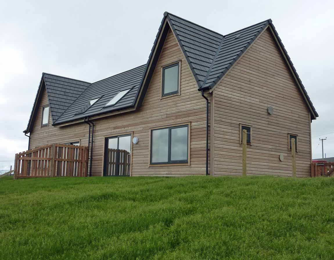 New  Building, Redman + Sutherland Architects,Hjaltland Housing Association, Brough View, Cullivoe, Shetland, timber cladding